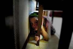 Child hiding under table