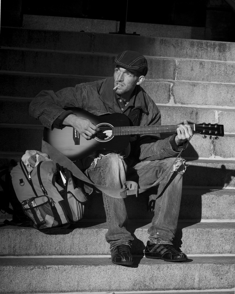 Man playing guitar on steps